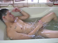 'Young Latin Guy Having Fun Alone in the Bathtub'