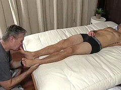 Sleeping hairy man soles licked and toe fellated by a mature deviant