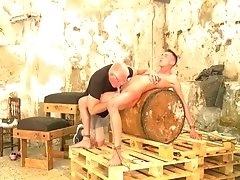 The perverse oldie milks a young stud on a barrel