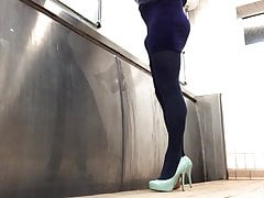 Peeing in blue velvet pantyhose in public toilet .
