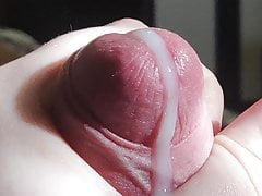 Huge cumshot while watching porn. Man wanking bug cock
