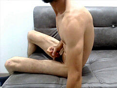 youthful lean college boy strokes his big cock and spunk