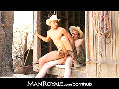 Manroyale - 2 cowboy men plow outdoors